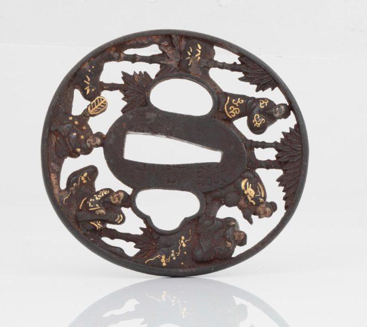 Tsuba. Brass with gilt details. Meiji period.
