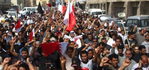 People marching through the streets of Sitra